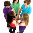 Friends putting hands together — Stock Photo