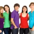 Five young friends standing together — Stockfoto