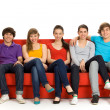 Friends sitting on couch — Foto de Stock
