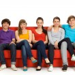 Friends sitting on couch — Stock Photo