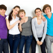 Stock Photo: Five young friends standing together
