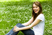 Young woman sitting on grass — Stock Photo