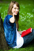 Female student with thumbs up — Stock Photo