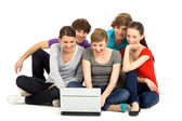 Friends using laptop — Stock Photo