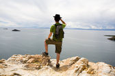 Tourist looking at Lake Titicaca — Stock Photo