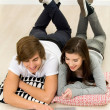 Young couple using laptop — Stock Photo