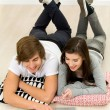 Young couple using laptop — Stock Photo #28194109