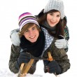 Young couple on sled in snow — Stock Photo