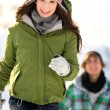 Couple running in the snow — Stock Photo #28195481