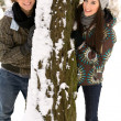 Couple outdoors by tree smiling — Stock Photo