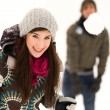 Stock Photo: Couple having snowball fight