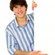 Young man holding blank poster — Stock Photo