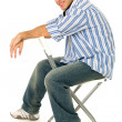 Young Man Sitting in Chair — Stock Photo