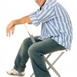 Stock Photo: Young Man Sitting in Chair