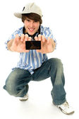 Cool young guy with mp3 player — Stock Photo
