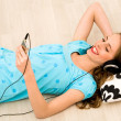 Stock Photo: Girl listening to mp3 player