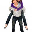 Guy giving girlfriend a piggyback ride — Stock Photo