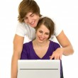 Teenage couple with laptop — Stock Photo