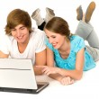 Couple lying on floor using laptop — Stock Photo