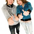 Stock Photo: Happy teenagers with thumbs up