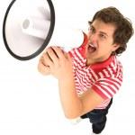 Young Man Shouting Through Megaphone — Stock Photo #28207007