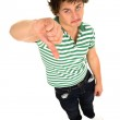 Young man with thumbs down — Stock Photo
