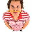Stock Photo: Mwith pencil under his nose
