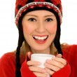 Stock Photo: Womwearing winter hat and holding cup