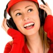 Stock Photo: Young womwith MP3 player