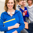 Female student with friends — Stock Photo