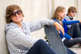 Teenager with skateboard — Stock Photo