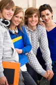 Four students standing together — Stock Photo