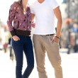 Young couple standing on street — Stock Photo