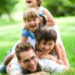 Family lying on grass — Stock Photo #28260739