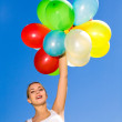 Woman holding bunch of balloons — Stock Photo