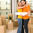 Couple hugging in new house — Stock Photo