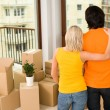 Couple standing in new house — Stock Photo