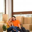 Couple sitting in new home — Stock Photo