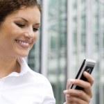 Businesswoman using palmtop — Stock Photo