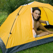 Man camping in tent — Stock Photo