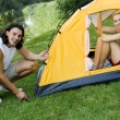 Couple pitching tent — Stock Photo