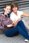 Teens with cellphones — Stock Photo