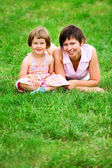 Mother and daughter on grass — Stock Photo
