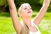 Woman with arms raised — Stock Photo