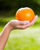 Orange on hand — Stock Photo