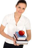 Female teacher holding books — Stock Photo