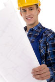 Manual worker examining blueprints — Stock Photo