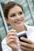 Businesswoman using palmtop — Stock Photo