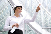 Woman in hardhat pointing finger — Stock Photo