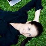 Businesswoman sleeping beside a laptop — Stock Photo #28270177